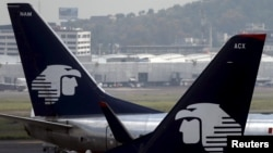 FILE - Aeromexico aeroplanes are seen on the airstrip at Benito Juarez international airport in Mexico City, July 8, 2015.