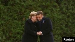 Tổng thống Emmanuel Macron (phải) và Thủ tướng Đức Angela Merkel ở Compie2gne, Pháp, ngày 10 tháng 11, 2018