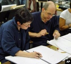 Robert Spano confers with Pulitzer Prize-winning composer Jennifer Higdon.