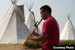 Ojibwe flutist Darren Thompson . Photo by Matt Kelly