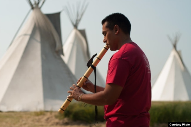 Ojibwe flutist Darren Thompson  Photo by Matt Kelly