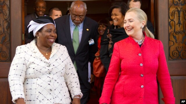 Secretary of State Hillary Rodham Clinton walks out with then African Union Chair-Designate Nkosazana Dlamini-Zuma after their meeting in Pretoria, South Africa, Aug. 7, 2012.