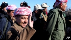 FILE - Iraqi Kurdistan President Massoud Barzani (L) is seen in a Dec. 21, 2014, photo in the town of Sinjar, Iraq.