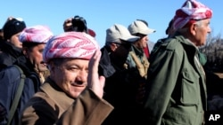 Kurdistan Iraqi regional government President Massoud Barzani arrives to support Kurdish forces as they head to battle Islamic State militants, on the summit of Mount Sinjar, in the town of Sinjar, Iraq, Dec. 21, 2014.