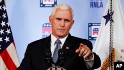 FILE - Vice President Mike Pence gestures while speaking in Washington, Aug. 24, 2018.
