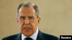 FILE - Russian Foreign Minister Sergei Lavrov recommends pulling back smaller-caliber weapons from the front lines of the Ukraine conflict.