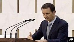 Tổng thống Syria Bashar al-Assa đọc diễn văn trên đài truyền hình nhà nước Syria, ngày 26/7/2015.