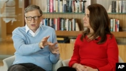 In this Feb. 1, 2018 file photo, Microsoft co-founder Bill Gates and his wife Melinda take part in an AP interview in Kirkland, Wash. (AP Photo/Ted S. Warren, file)