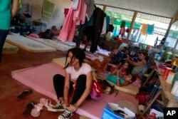 Cuban migrants relax at a temporary shelter in La Cruz, Costa Rica, Jan. 12, 2016.