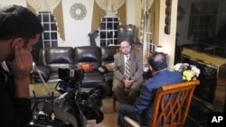 Dr. Mohammad Abu-Salha, whose two daughters and son-in-law were killed last February by a disgruntled neighbor, speaks with an Al Jazeera America crew in Raleigh, N.C., about growing anti-Muslim sentiment in his adopted country, Dec. 9, 2015.