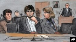 In this courtroom sketch, Dzhokhar Tsarnaev, center, is depicted between defense attorneys Miriam Conrad, left, and Judy Clarke, right, during his federal death penalty trial, March 5, 2015, in Boston.