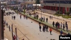 FILE - Anti-government demonstrators block a road in Bamenda, Cameroon, Dec. 8, 2016.