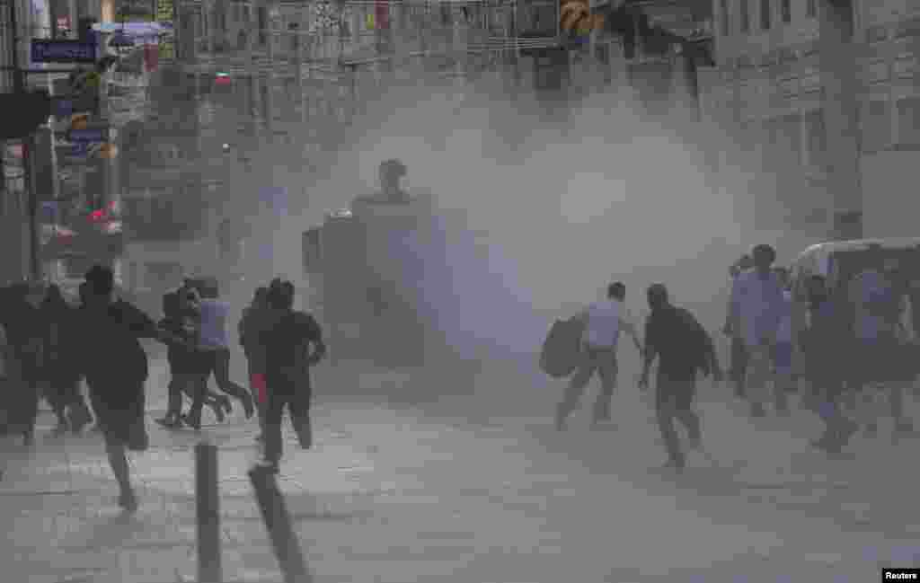 Riot police use a water cannon to disperse protesters in central Istanbul, July 8, 2013.