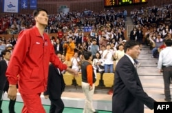 North Korean basketball player Ri Myoung-Hun is cheered by the crowd in South Korea in Sept. 2002 at the 14th Asian Games.