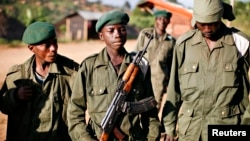 """File - A child soldier (C), known as """"Kadogo,"""" meaning """"small one"""" in Swahili, stands at the front line at Kanyabayonga in eastern Congo."""