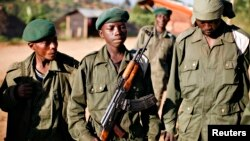 "A child soldier (C), known as ""Kadogo,"" meaning ""small one"" in Swahili, stands at the front line at Kanyabayonga in eastern Congo, November 17, 2008."