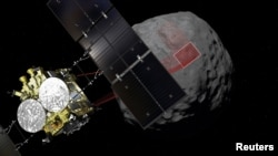 A computer graphic handout image shows Japan Aerospace Exploration Agency's Hayabusa 2 probe arrives to asteroid Ryugu, in this image released by Japan Aerospace Exploration Agency and obtained by Reuters on February 22, 2019.