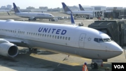 FILE - United Airlines will cease flights to Lagos, Nigeria's largest city, in June.