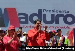 FILE - Venezuela's President Nicolas Maduro and his wife, Cilia Flores, take part in a campaign rally in Ciudad Guayana, Venezuela, April 23, 2018.