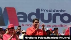 El presidente Nicolás Maduroy su esposa Cilia Flores durante un acto de campaña en Ciudad Guayana, Venezuela, el 23 de abril, de 2018.