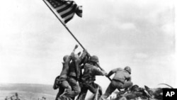 Joe Rosenthal's photo of Marines of the 28th Regiment of the Fifth Division raising the American flag atop Mount Suribachi, Iwo Jima, on February 23, 1945