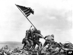 Joe Rosenthal's photo of Marines raising the American flag at Iwo Jima.