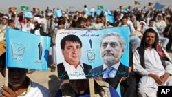 Supporters of Afghan presidential candidate Abdullah Abdullah attend a campaign rally in the Paghman district of Kabul, Afghanistan, June 9, 2014.