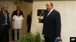 This Sept. 9, 2015 image released on the official Facebook page of the Israeli Embassy in Egypt shows Dore Gold, Israel's Foreign Ministry director-general at the re-opening of the embassy in Cairo, Egypt, four years after an Egyptian mob ransacked the site where the mission was previously located.