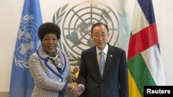 U.N. Secretary-General Ban Ki-moon, right, shakes hands with the head of state of the transitional government of the Central African Republic Catherine Samba-Panza ahead of the United Nations General Assembly at the U.N. headquarters in New York, Sept. 24, 20