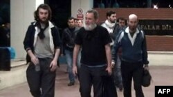 Screengrab from a video released by Dogan News Agency shows (from L) Edouard Elias, Didier Francois, Pierre Torres and Nicolas Henin arriving at the Mehmet Akif Inan Training & Research Hospital at Sanliurfa, near the Syrian border, Apr. 19, 2014.