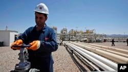 FILE - An employee works at Tawke oil fields in northern Iraq's Kurdish region.