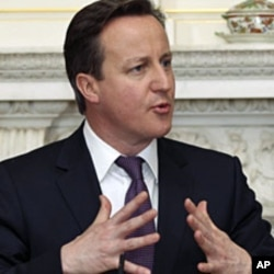Britain's Prime Minister David Cameron (L) speaks during a joint news conference with Ireland's Taoiseach Enda Kenny in 10 Downing Street, London, March 12, 2012
