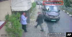 This image taken from CCTV video obtained by the Turkish newspaper Hurriyet and made available on Oct. 9, 2018, claims to show Saudi journalist Jamal Khashoggi entering the Saudi consulate in Istanbul, Oct. 2, 2018.