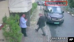 FILE - This image taken from CCTV video obtained by the Turkish newspaper Hurriyet and made available on Oct. 9, 2018 claims to show Saudi journalist Jamal Khashoggi entering the Saudi consulate in Istanbul, Oct. 2, 2018.
