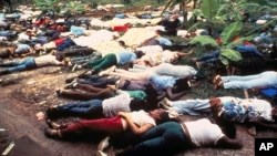 Bodies of members of the People's Temple lwho committed suicide under the direction of cult leader Jim Jones lay strewn around the group's compound in Jonestown, Guyana in 1978.