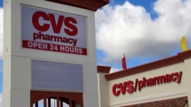 FILE-  A CVS pharmacy in Hialeah Gardens, Florida. The company says it will stop selling all tobacco products by October 1.