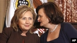 Cherie Blair, wife of former British Prime Minister Tony Blair, founder of the Cherie Blair Foundation for Women, talks with Secretary of State Hillary Rodham Clinton, at the State Department in Washington, Thursday, Oct. 7, 2010, during the launch of the