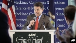 Republican presidential candidate Texas Governor Rick Perry addresses the Republican Leadership Conference at the Grand Hotel on Mackinac Island, Michigan, September 24, 2011.