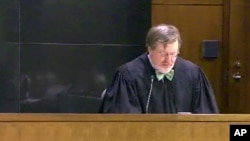 FILE - This image taken from United States Courts shows Judge James Robart listening to a case, March 12, 2013, in Seattle, Washington. Robart placed a nationwide hold on President Donald Trump's executive order banning travel to the United States by migrants from seven Muslim-majority countries.
