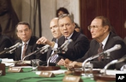 FILE - Sen. Orrin Hatch, R-Utah, questions professor Anita Hill, Oct. 11, 1991, in Washington during a Senate Judiciary Committee hearing on the nomination of Clarence Thomas to the Supreme Court. From left are: Chuck Grassley, R-Iowa, Alan Simpson, R-Wyo, Arlen Specter, R-Pa., Hatch, R-Utah, and Strom Thurmond, R-S.C.