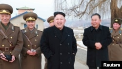 North Korean leader Kim Jong Un, center, in an undated photo released by North Korea.