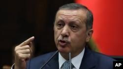 Turkish Prime Minister Recep Tayyip Erdogan addresses his lawmakers in Ankara, Feb. 25, 2014.