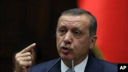 FILE - Turkish Prime Minister Recep Tayyip Erdogan addresses lawmakers in Ankara, Turkey.