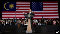 President Barack Obama gestures as he speaks during a town hall meeting at Malaya University in Kuala Lumpur, Malaysia, Sunday, April 27, 2014.