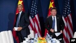 美国总统奥巴马和中国主席习近平在联合国气候大会上(2015年11月30日)