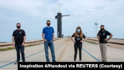 Jared Isaacman, Hayley Arceneaux, Sian Proctor and Chris Sembroski pose for a photo at NASA's Kennedy Space Center at Cape Canaveral, Florida, U.S., March 29, 2021 in this handout image provided by SpaceX. Picture taken March 29, 2021.