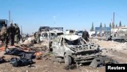 Hiện trường sau vụ đánh bom xe tại khu ngoại ô thành phố Hama, ngày 20/10/2013.