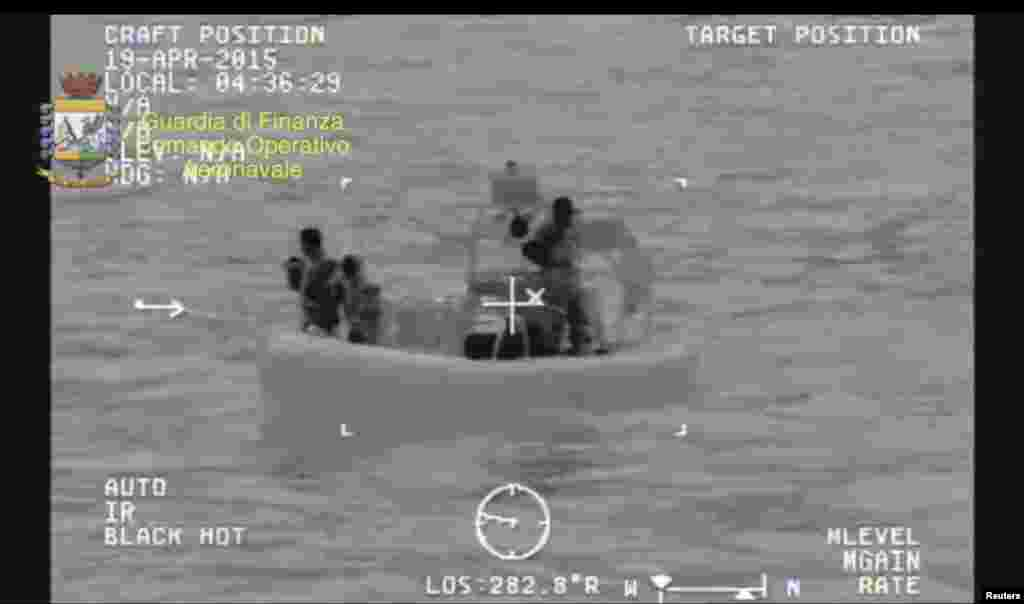 A rescue vessel is seen during the search and rescue operation under way after a boat carrying migrants capsized overnight, with up to 700 feared dead, in this still image taken from video released by Italian Guardia di Finanza, April 19, 2015.