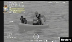 A rescue vessel is seen during the search and rescue operation underway after a boat carrying migrants capsized overnight, with up to 700 feared dead, in this still image taken from video released by Italian Guardia di Finanza, April 19, 2015.