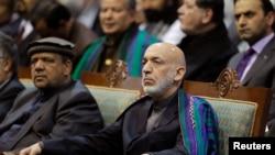 Presiden Afghanistan Hamid Karzai menghadiri hair terakhir pertemuan Loya Jirga, Kabul (24/11).